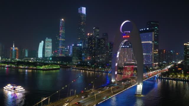 night illuminated guangzhou city downtown river traffic bridge aerial panorama 4k china video