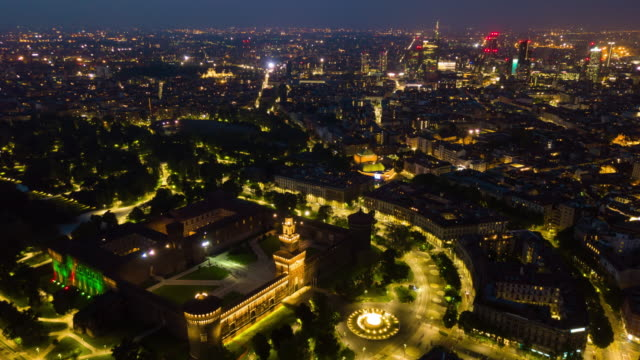 night illuminated malan city center park aerial panorama 4k time lapse italy video