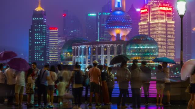 night illuminated shanghai bund bay crowded panorama 4k timelapse china night time illuminated shanghai famous bund bay crowded panorama 4k timelapse china shanghai stock videos & royalty-free footage