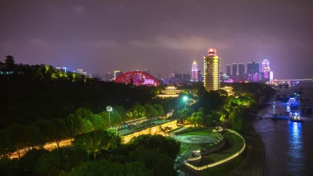 night illuminated wuhan city riverside dayu shenhua park monument panorama 4k time lapse china