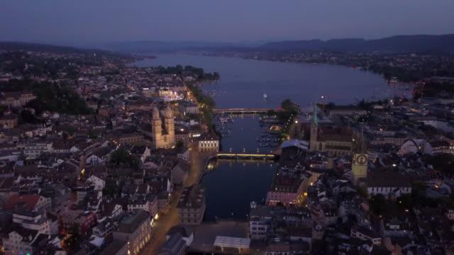 night illuminated zurich city center riverside lake view aerial panorama 4k switzerland - vídeo