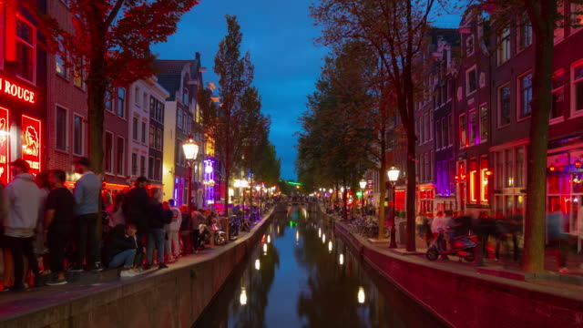 night illumination amsterdam city famous red lights district canal panorama 4k timelapse netherlands night illumination amsterdam city famous red lights district canal panorama 4k timelapse netherlands dutch architecture stock videos & royalty-free footage