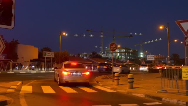 night illumination dubai city traffic street hotel construction panorama 4k united arab emirates video
