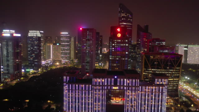 night illumination hangzhou city downtown modern buildings aerial panorama 4k china - vídeo