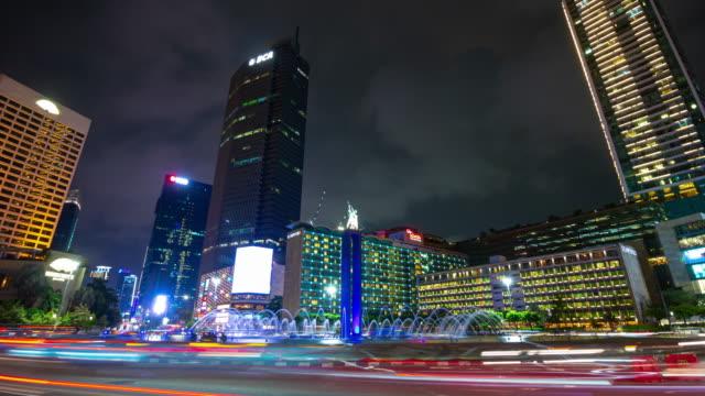 night illumination jakarta city center famous traffic street circle fountain timelapse panorama 4k indonesia video
