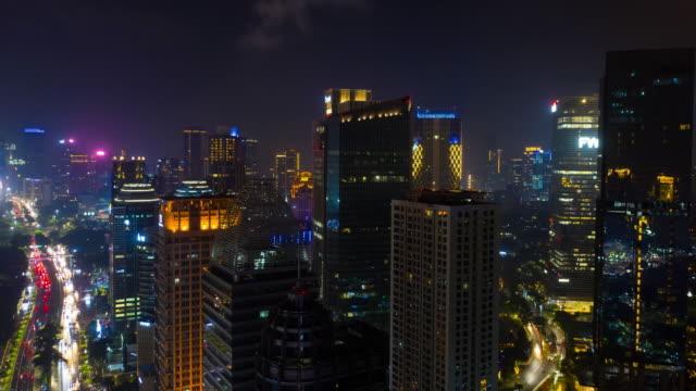 night illumination jakarta city modern downtown traffic streets aerial timelapse panorama 4k indonesia video