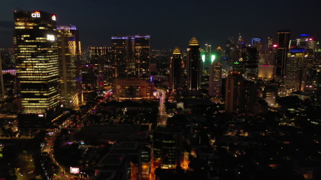 night illumination jakarta city modern downtown traffic streets aerial panorama 4k indonesia - vídeo