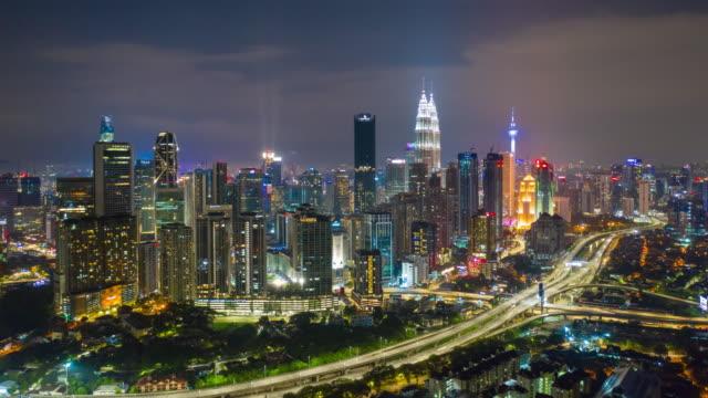 night illumination kuala lumpur cityscape downtown traffic road jam aerial panorama 4k timelapse malaysia - kuala lumpur video stock e b–roll