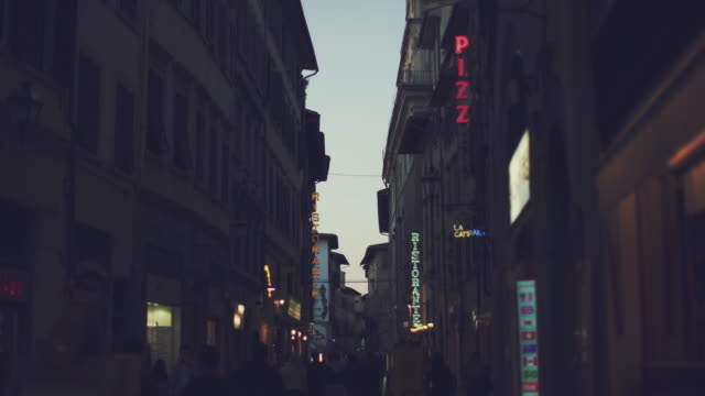 Night life and signs in Florence, Italy