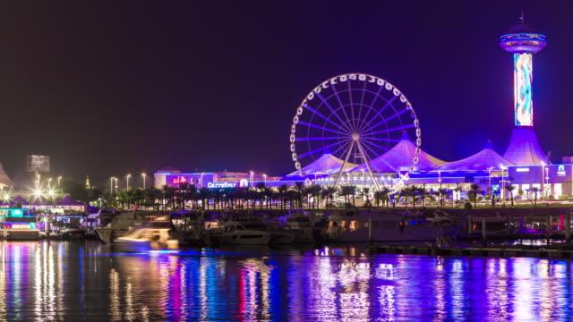 gece ışık abu dabi şehir ünlü marina alışveriş merkezi park panorama 4 k zaman sukut birleşik arap emirlikleri - abu dhabi stok videoları ve detay görüntü çekimi