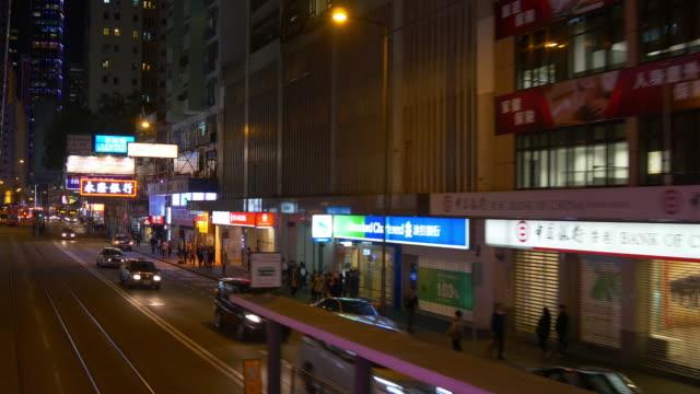 night light hong kong downtown crowded tram traffic street panorama 4k china video