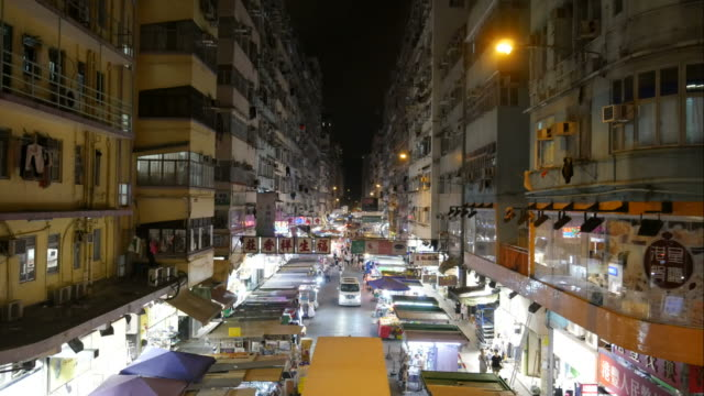 Night market and apartment buildings in Hong Kong video