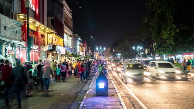 Night market in Yogyakarta Traffic crowd shopping Malioboro street in Yogyakarta, Indonesia. 4K Resolution 3840x2160 Format indonesia stock videos & royalty-free footage