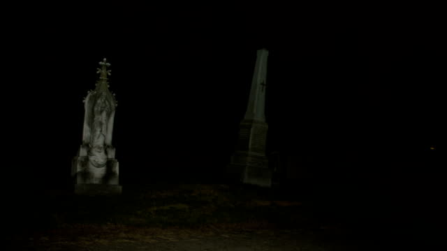 Night pan across cemetery graveyard video