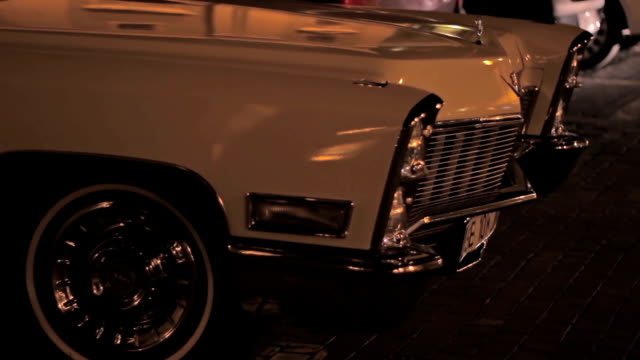 Night Parked Old Car Retro beautiful old car, waiting in hot dark summer night. luxury car stock videos & royalty-free footage