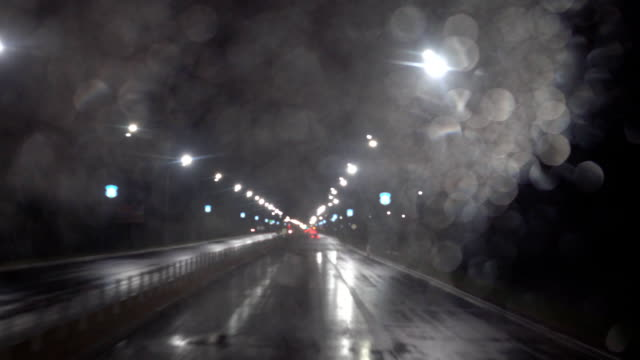 night road. shooting from the car on the track. car driving forward. it rains, drops on the left glass. Shooting from a double-decker bus. 4л video