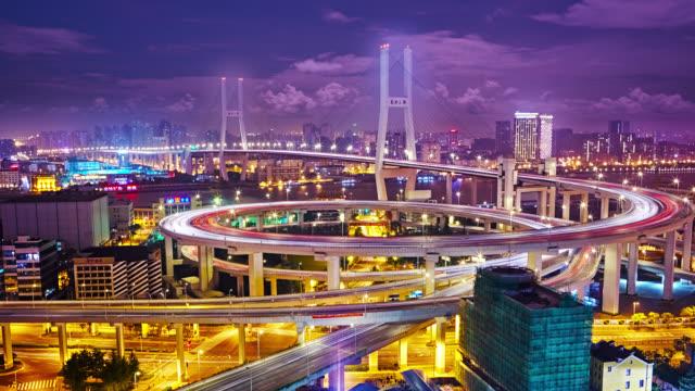 night rush hour traffic spirals around Nanpu Bridge video