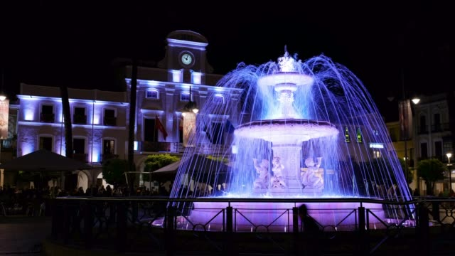 Night scene of Fountain of the Spain Square in operation with its recently released artistic lighting, in the city of Merida