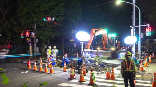 night scene of road repair constructions site in tokyo at night. video