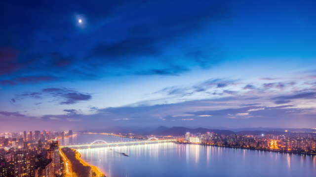 night scene of west lake and cityscape of hangzhou in blue sky. timelapse 4k video