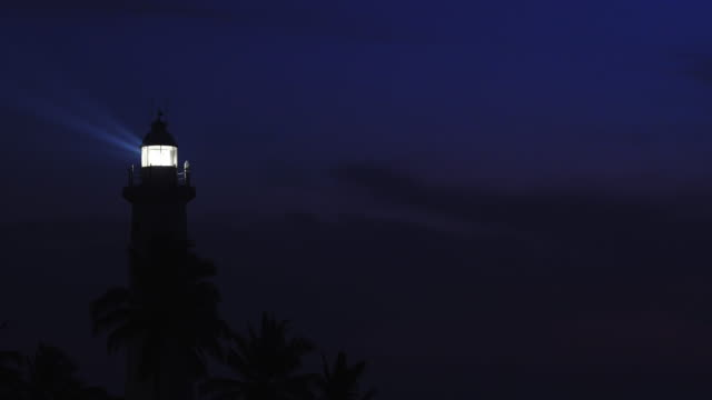 Night seascape with lighthouse