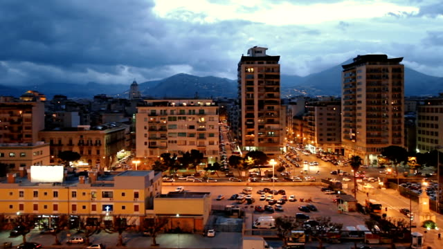 night shot of palermo port district from cruise ship deck. - palermo città video stock e b–roll