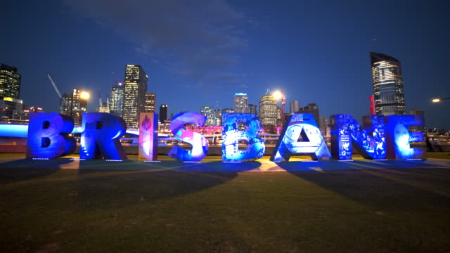 night shot of the large brisbane letters changing colors at south bank in brisbane video