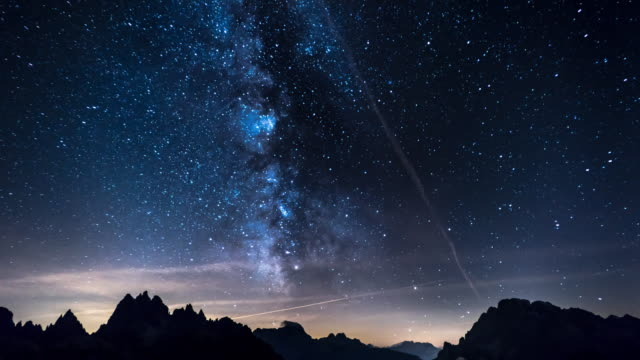 Night sky of stars time-lapse - Milky Way and Over the mountain background video