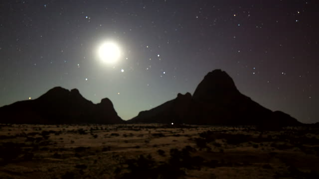 t/l ws night sky over the spitzkoppe - moon stock videos & royalty-free footage
