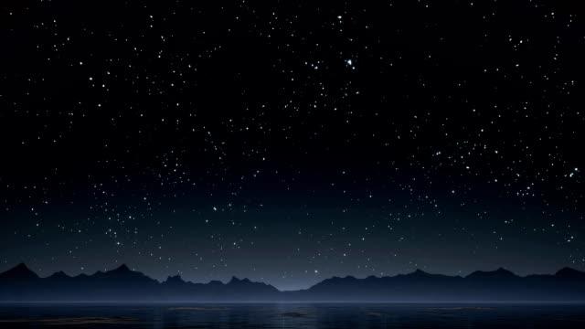 gece gökyüzünde parlayan yıldız ile - ünlüler stok videoları ve detay görüntü çekimi