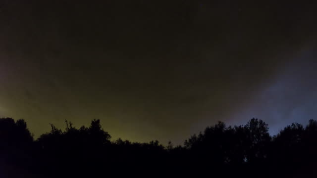 Night sky with thunderstorms time lapse video