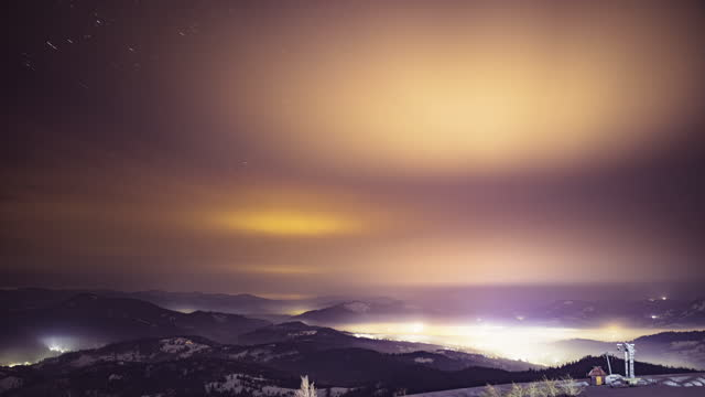 Night starry sky over village in Carpathians