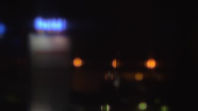 Night street view with illuminated hotel banner video