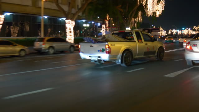 night time bangkok traffic street trip taxi ride backside window panorama 4k thailand video