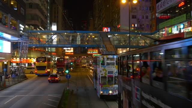 night time hong kong famous tram traffic street road trip panorama 4k china video