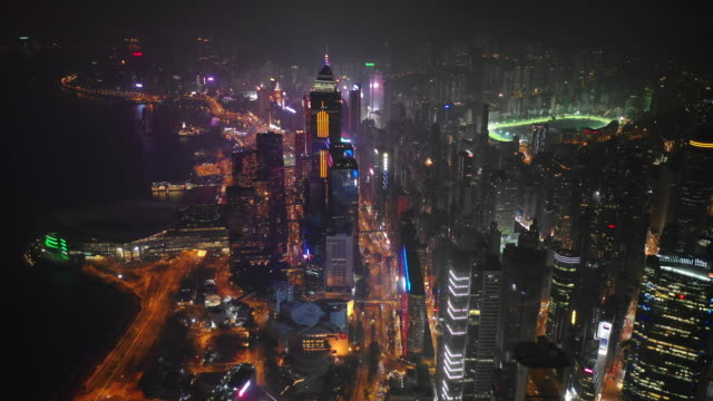 night time illuminated hong kong city downtown bay traffic street aerial panorama 4k - hong kong video stock e b–roll