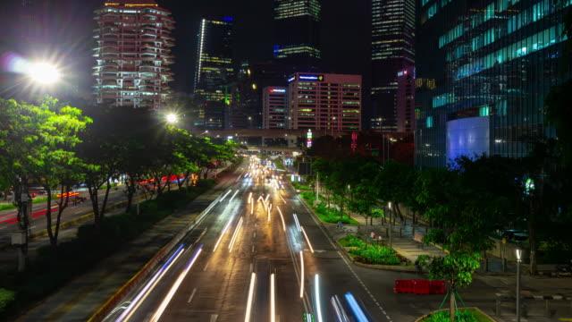Nacht zeit beleuchtet jakarta Stadt Innenstadt belebte Verkehrsstraße Brücke Zeitraffer Panorama 4k indonesien – Video