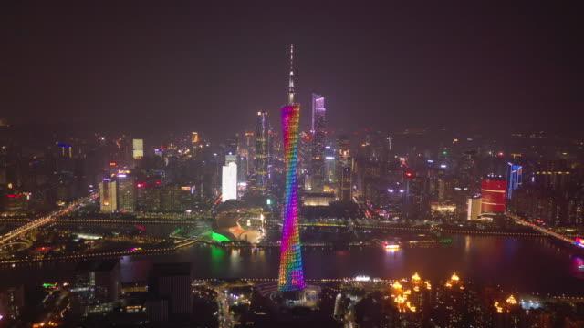 night time illumination guangzhou city downtown famous towers riverside bay aerial panorama 4k china video