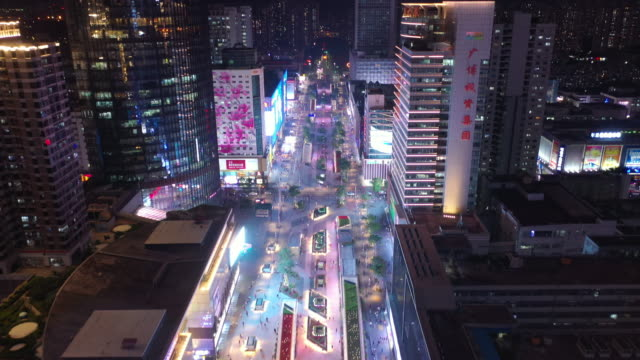 night time illumination shenzhen city famous commercial street aerial panorama 4k china - шэньчжэнь стоковые видео и кадры b-roll