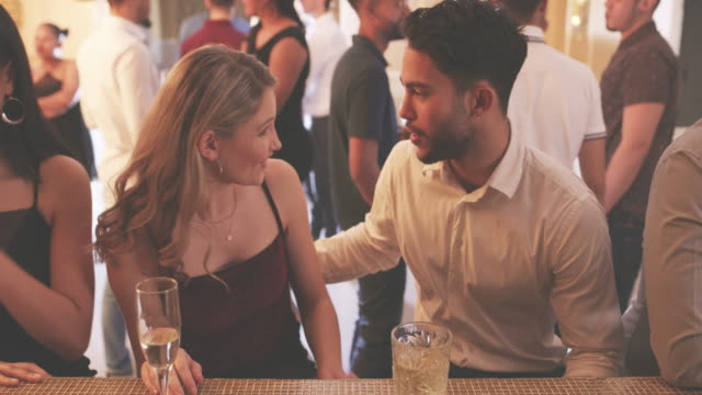 Night time is play time 4k video footage of a young man and woman chatting in a nightclub romance stock videos & royalty-free footage