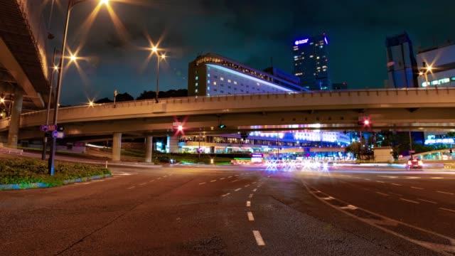 night time lapse in the business town in akasaka tokyo - время дня стоковые видео и кадры b-roll