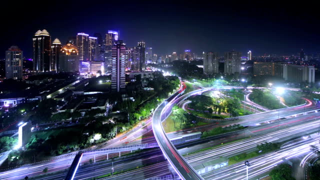 Night time lapse of Semanggi Juntion Night time lapse of Semanggi junction with Jakarta CBD area in the background jakarta stock videos & royalty-free footage