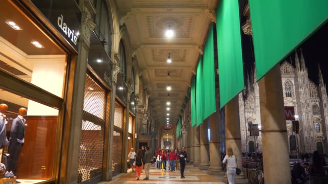 night time milan city center famous shopping gallery walking slow motion panorama 4k italy
