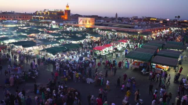 night time pan of the jemaa el-fnaa market in marrakech - souk video stock e b–roll