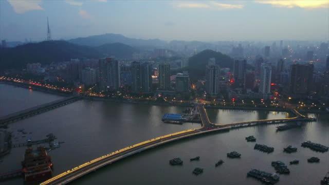 night time zhuhai bay cityscape port aerial panorama 4k china - zhuhai video stock e b–roll