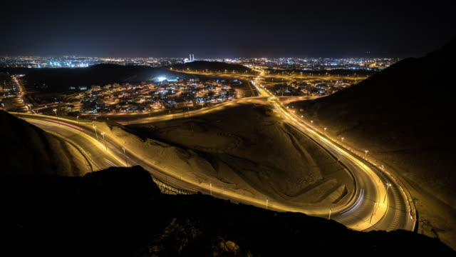 night timelapse of city and traffic lights in muscat, oman - oman filmów i materiałów b-roll