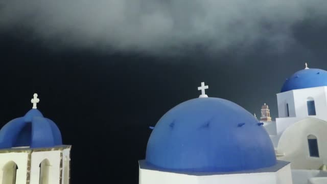 Night timelapse of the famous 3 blue domes in Oia on Santorini Island in Greece Night timelapse of the famous 3 blue domes in Oia on Santorini Island in Greece aegean islands stock videos & royalty-free footage