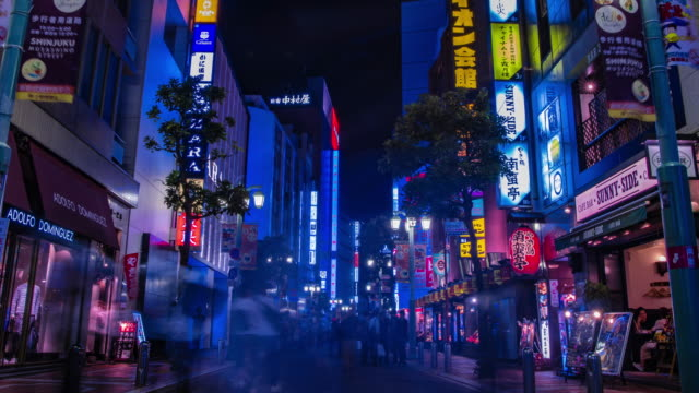 a night timelapse of the neon town in setagaya tokyo wide - segnale per macchine e pedoni video stock e b–roll