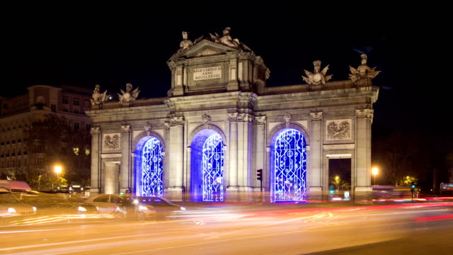 Night timelapse of the Puerta de Alcala decorated with Christmas lights. video