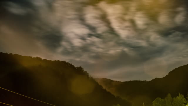 Night Timelapse with foggy moon and stars over mountains video